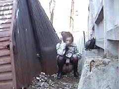 Kinky amateur bitch pissing in public place on spy camera