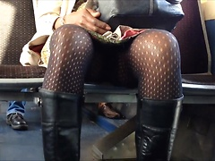Amateur upskirt video with black girl in pantyhose and boots on the train