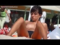 Hot nude beach porn with amateur brunette topless hottie sunbathing
